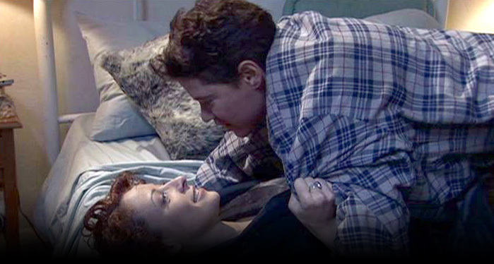 Sandy and Eddie on the bed: Soulmates The Movie